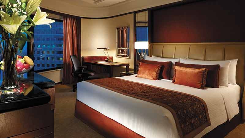 Lavish Deluxe Room with double bed and writing table at the Shangri-La Hotel in Kuala Lumpur