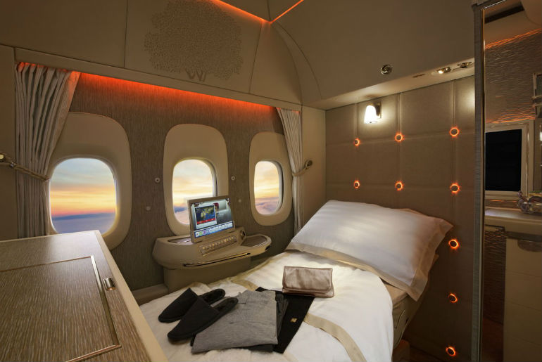 Emirates first class cabin with full amenities on the flat bed seat