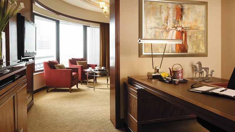 Executive Suite in the Shangri-La Hotel, Kuala Lumpur showing a large desk and window