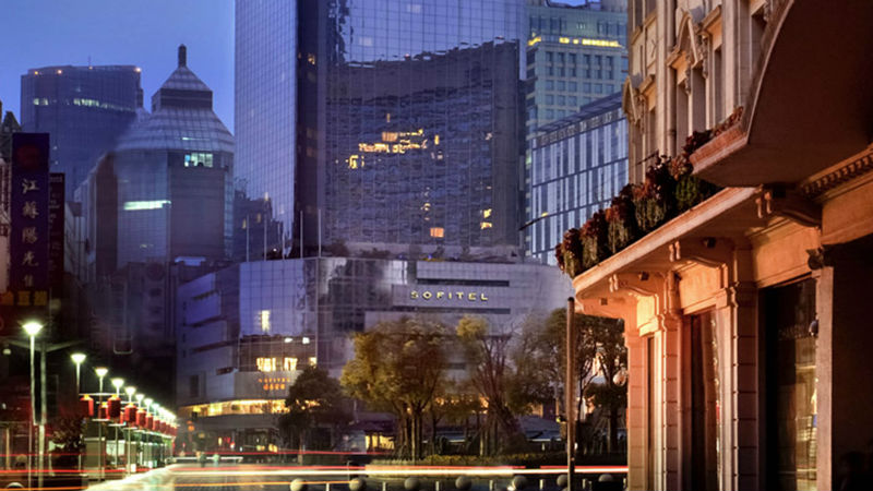 Busy street in front of the Sofitel Shanghai Hyland hotel