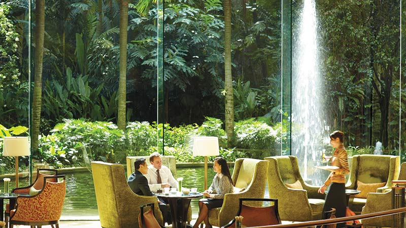 Lobby Lounge in front of a lush waterfall garden at the Shangri-La-Hotel in Kuala-Lumpur