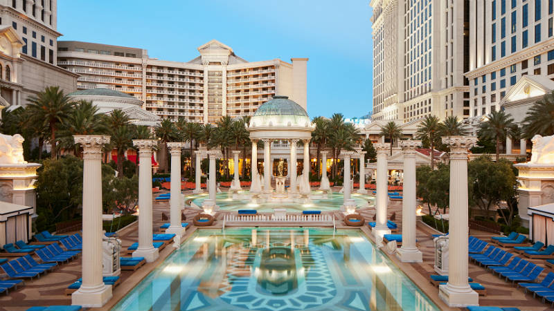The Neptune Pool surrounded by roman columns at Caesars Palace Las Vegas