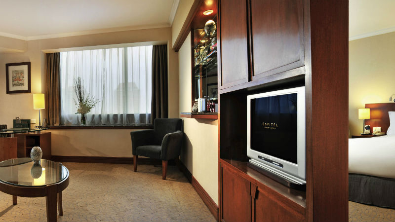 Prestige Suite Living Room at the Sofitel Shanghai Hyland showing the spilt wall for the bedroom