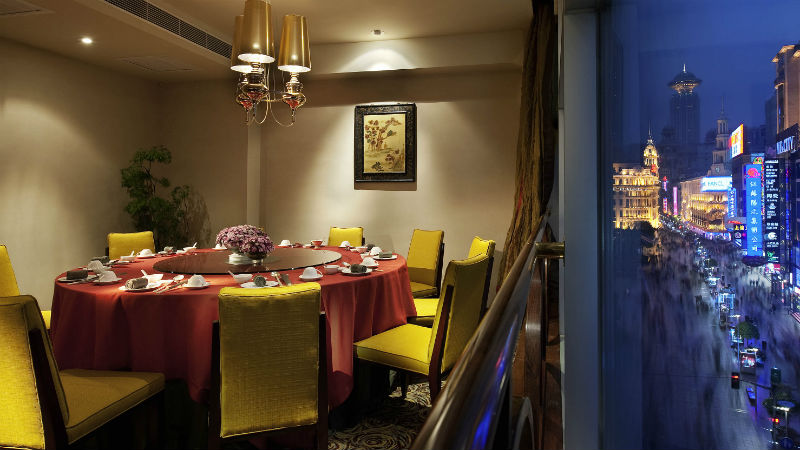 Private dining area at the Sofitel Shanghai Hyland with views of the city