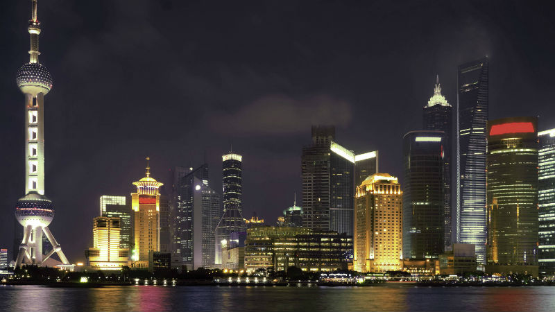 Shanghai skyline at night on the river bank