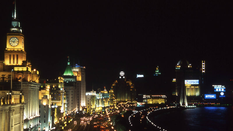 Shanghai skyline at night by the river