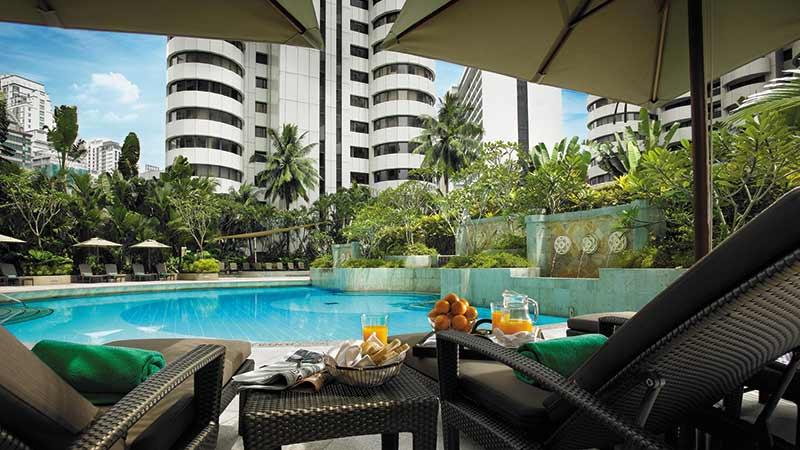 Two Deck chairs at the main Swimming Pool at Shangri-La-Hotel in Kuala-Lumpur
