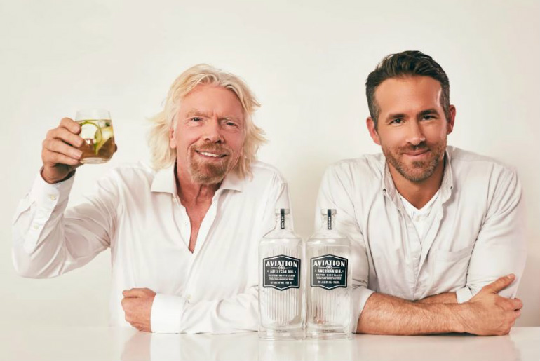 Ryan Reynolds & Sir Richard Branson with glass of Aviation Gin