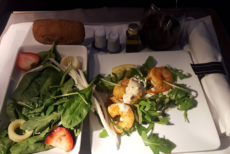 Prawns and salad with a glass of wine when I reviewed American Airlines business class