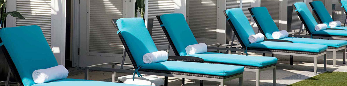 Sun Loungers by cabanas at the Boca Beach Club in Palm Beaches