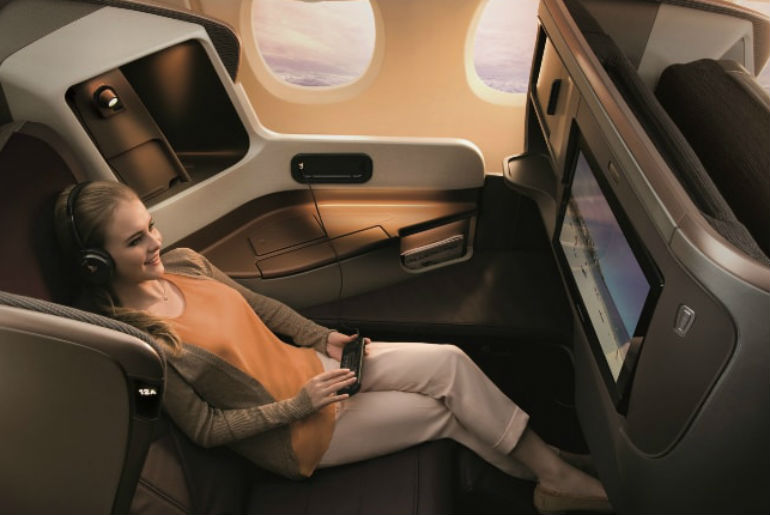 Woman relaxing in the Singapore Airlines business class seat