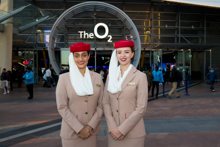 The Emirates cabin crew in front of the O2