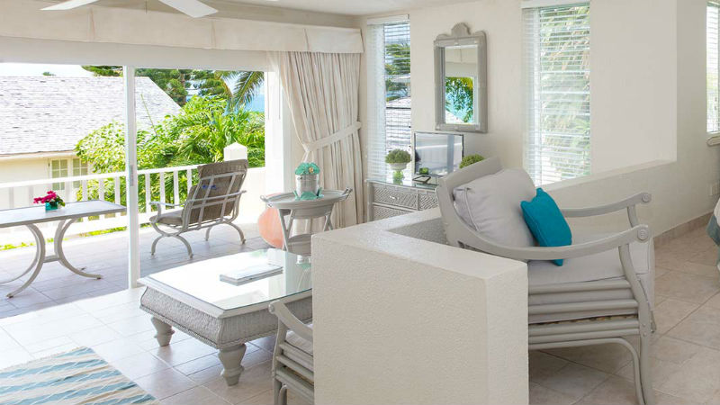 Living area and terrace of the Hillside Junior Suite at Blue Waters Antigua