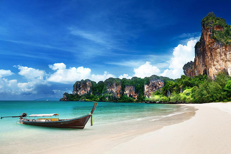 Longtail boat on a white sand beach in Krabi