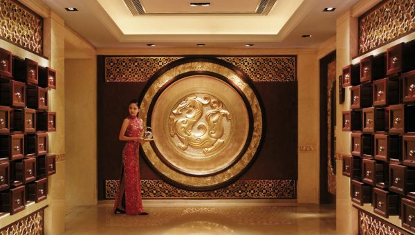 Woman welcoming guests at the China World Hotel foyer