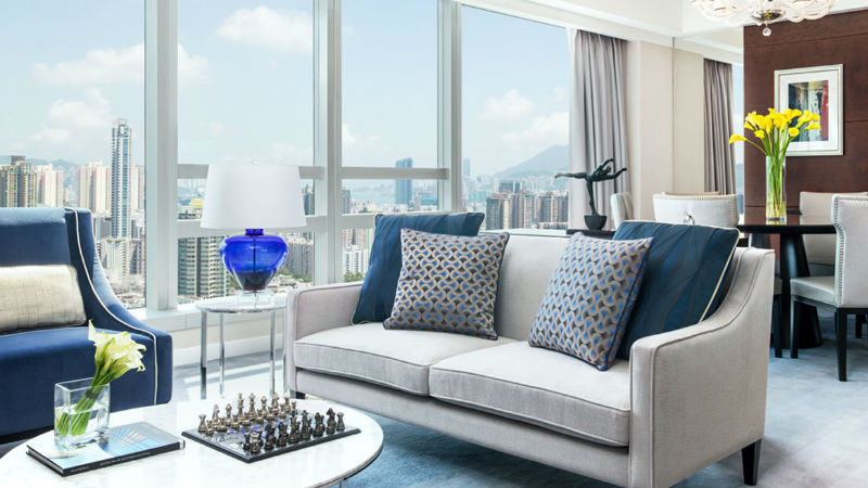 The Presidential suite at the Cordis Hong Kong showing bedroom view and sofa