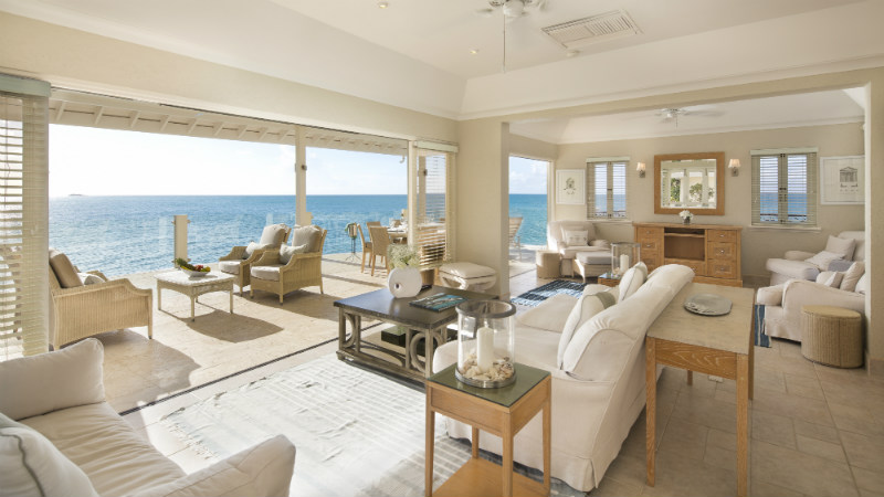 Expansive Living area opening to a balcony with ocean views at the Blue Waters Antigua