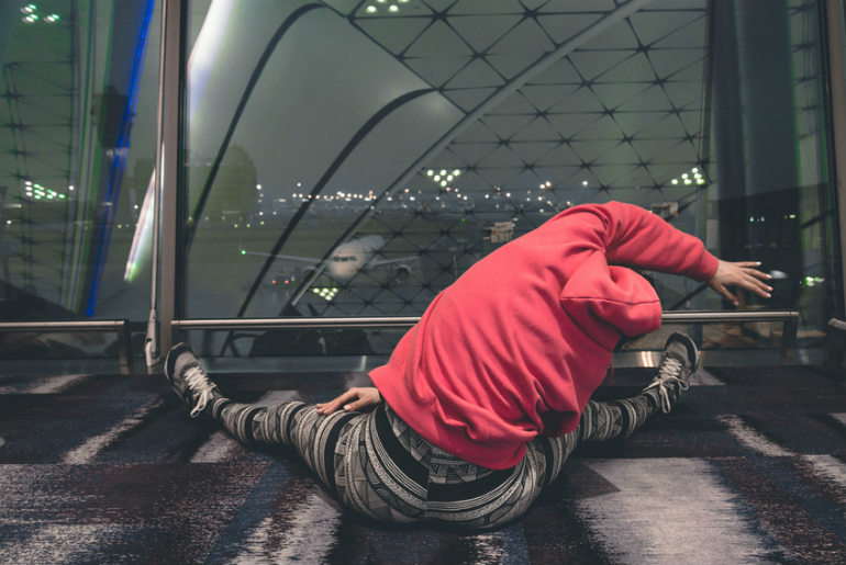 A person stretching at the airport