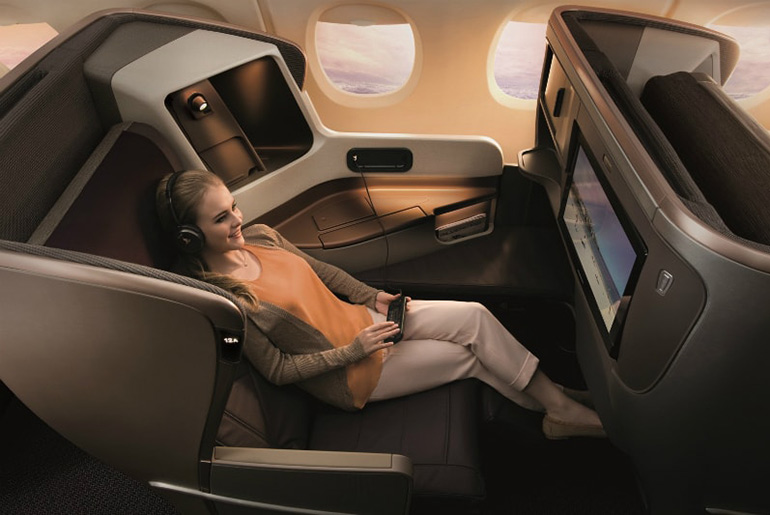 Lad relaxing in Singapore Airlines business class