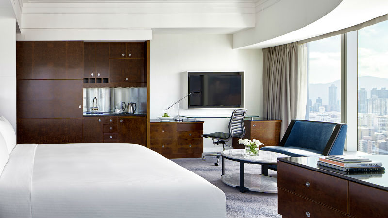 The Studio room at the Cordis Hong Kong showing bed and TV