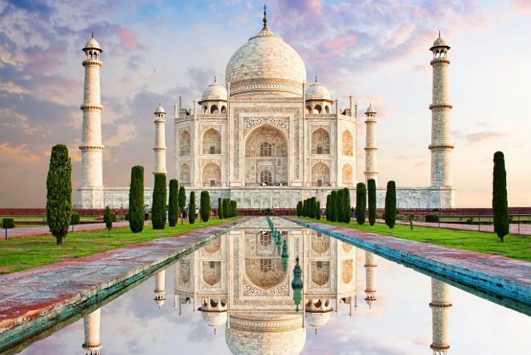 the front of the Taj Mahal in the bright sun