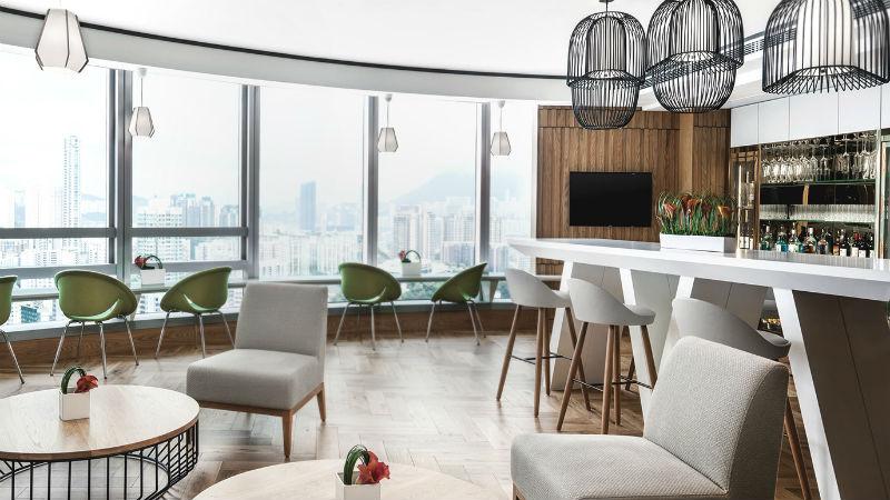 the club lounge bar at the Cordis Hong Kong with views of Hong Kong city skyline