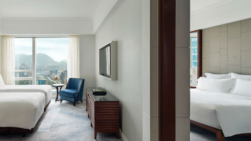 The family two bedroom room at the Cordis Hong Kong showing the split rooms