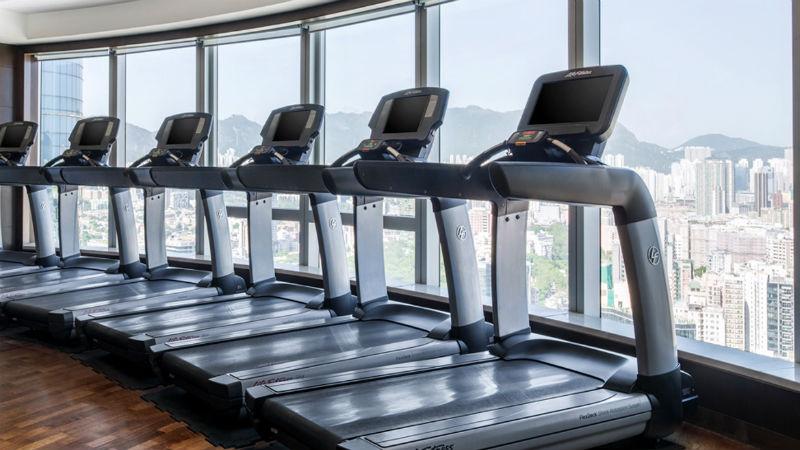 Health club fitness studio, showing treadmills at the Cordis Hong Kong hotel