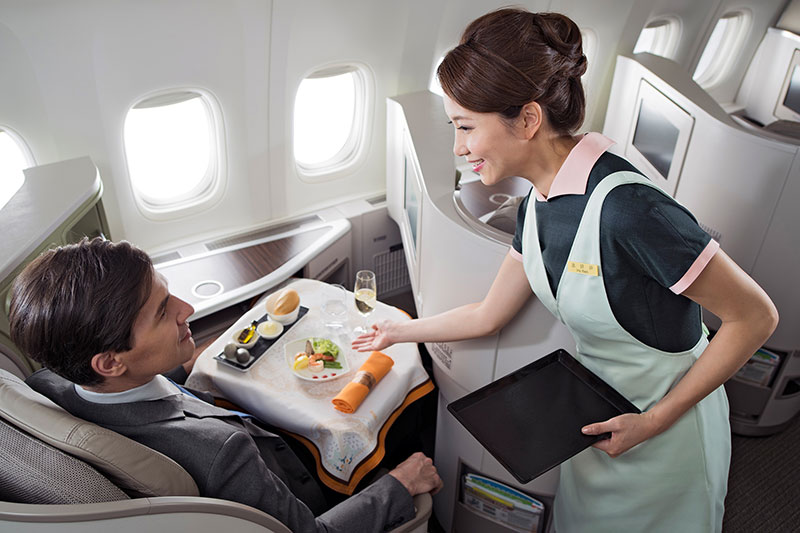 Man being served a meal in EVA Air business class