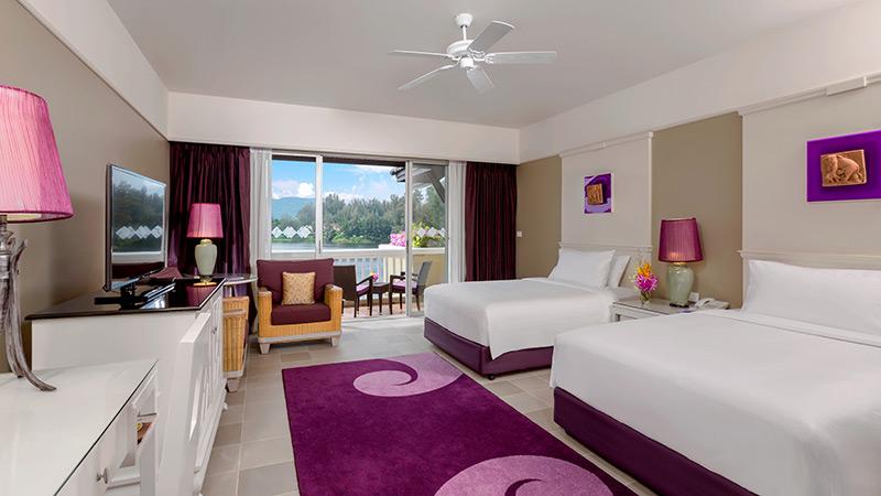 Bedroom and balcony of the Laguna Beachfront Room at Angsana Laguna Phuket