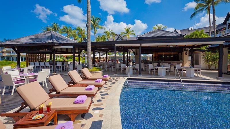 Sun loungers and poolside bar at Angsana Laguna Phuket