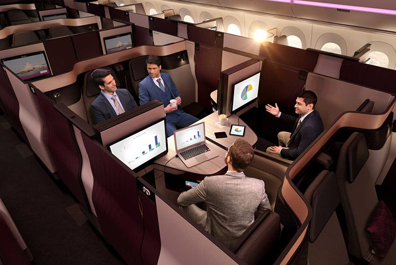 Business meeting being held in the Qatar Airways Qsuite