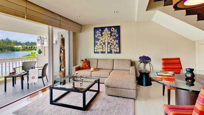 Living room and balcony of the Two Bedroom Island Duplex at Angsana Laguna Phuket