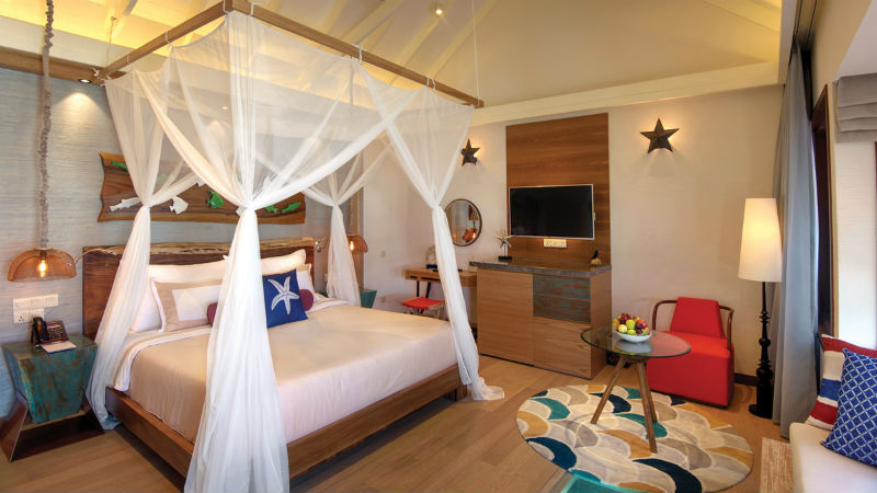 Canopy bed in the Water Villa at OBLU Select at Sangeli in the Maldives
