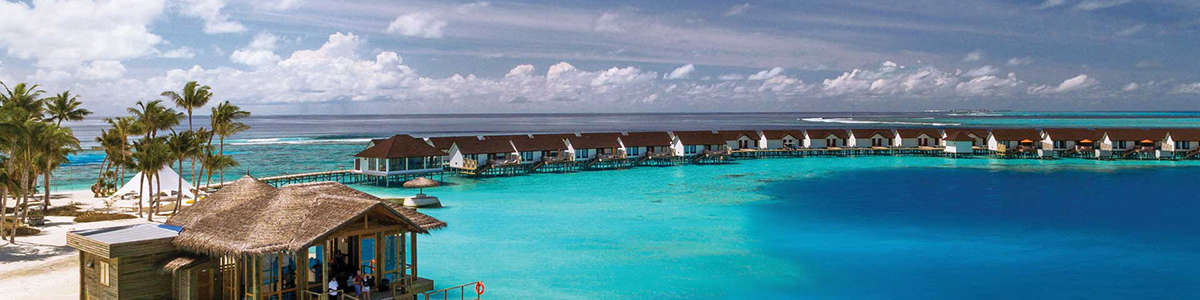 Water villas over blue water at OBLU Select at Sangeli in the Maldives