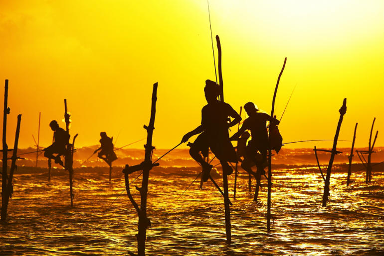 Traditional fisherman on stilts in the sea