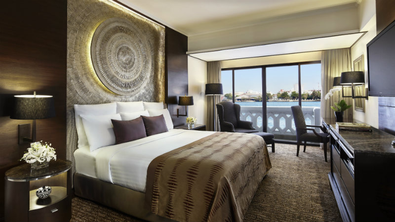 The Anantara Riverfront Suite Bedroom showing large bed and river