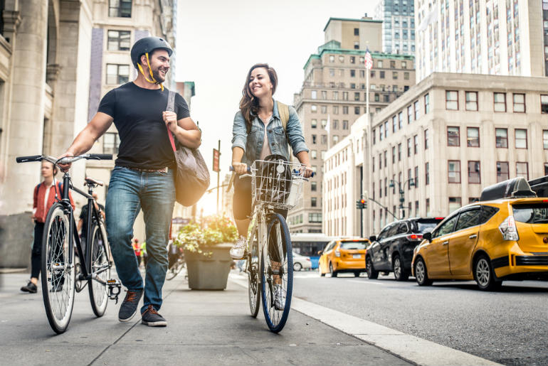 Couple cycling in New York