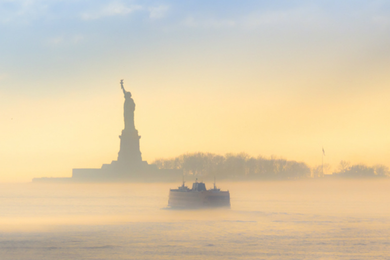 A view of the statue of liberty and boat