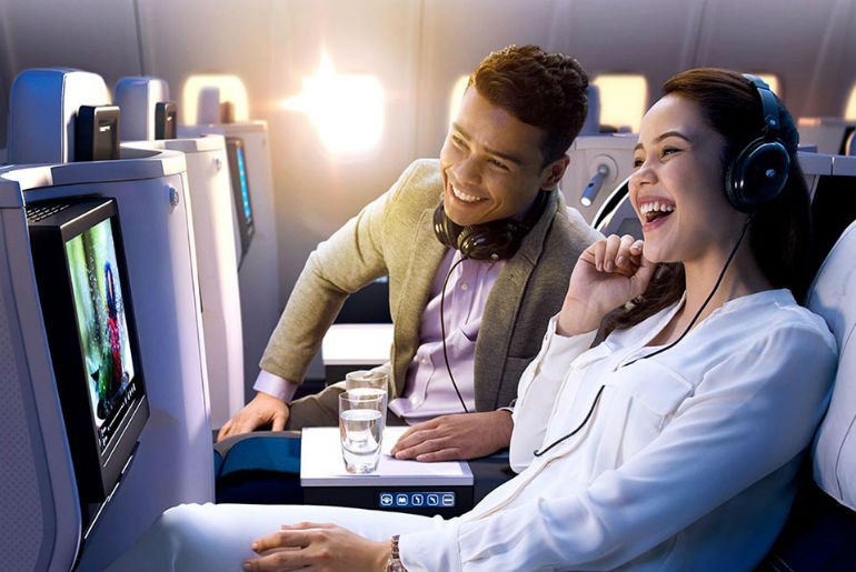 A couple watching Malaysia Airlines on board entertainment system