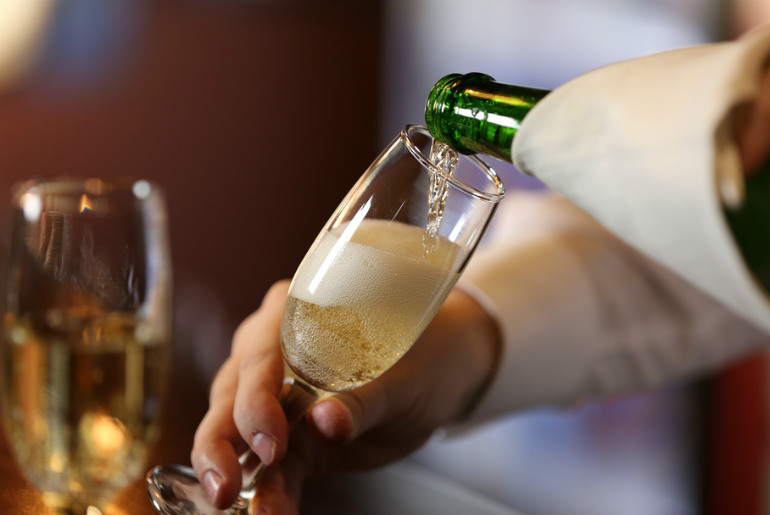 Champagne being Served on Business class flight