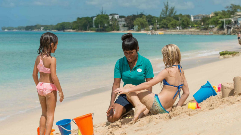 The hotel beach team playing with kids club at the Crystal Cove by Elegant Hotels