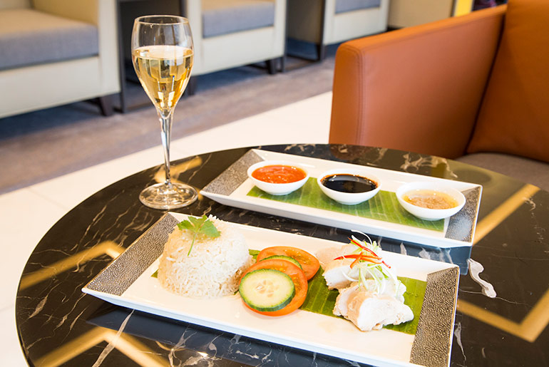 Chicken & Rice with a glass of champagne in the Singapore Airlines business class lounge