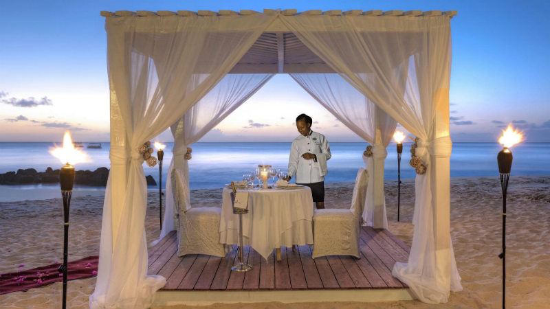Candle light Dining on the beach at the Crystal Cove by Elegant Hotels