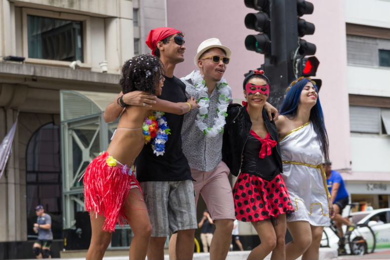 Group of friends on the way to Rio Carnival party