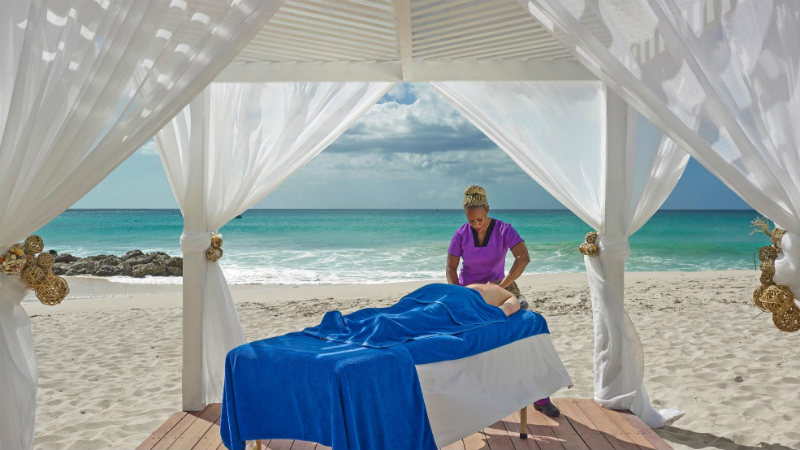 On the beach Massage service at the Crystal Cove by Elegant Hotels