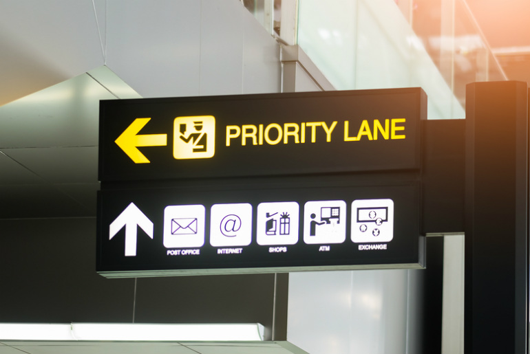 The Priority Boarding sign