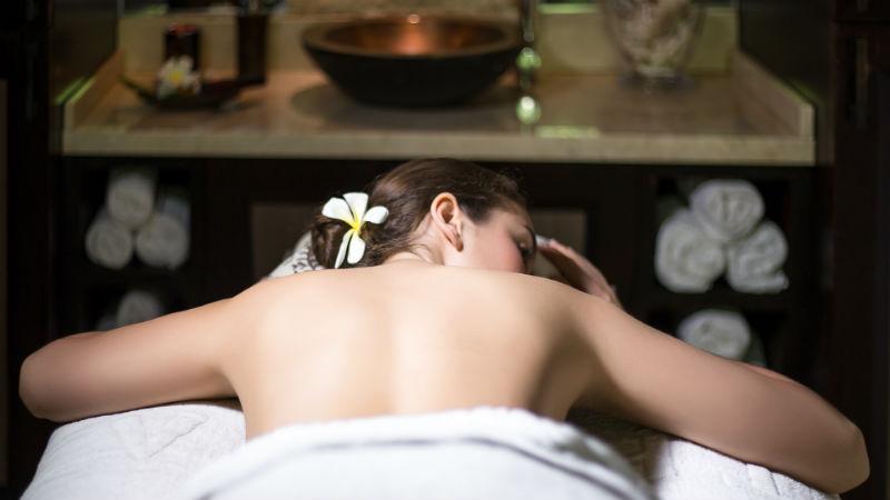 Woman recieving massage, Coral Reef Club Barbados