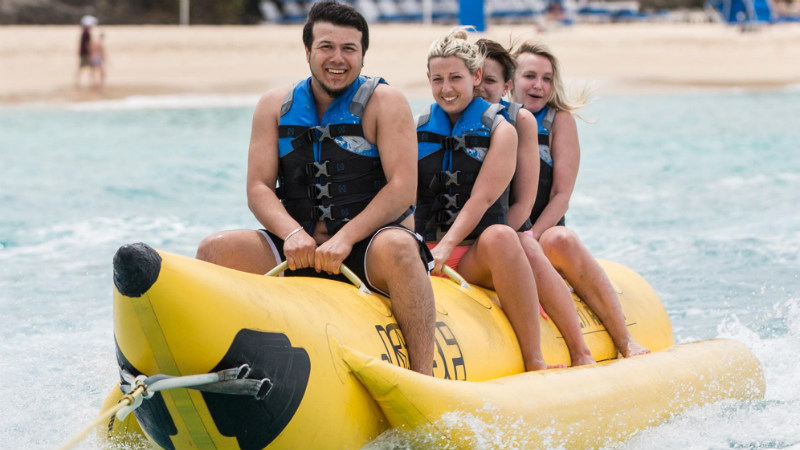 Banana boat with family riding at the Crystal Cove by Elegant Hotels