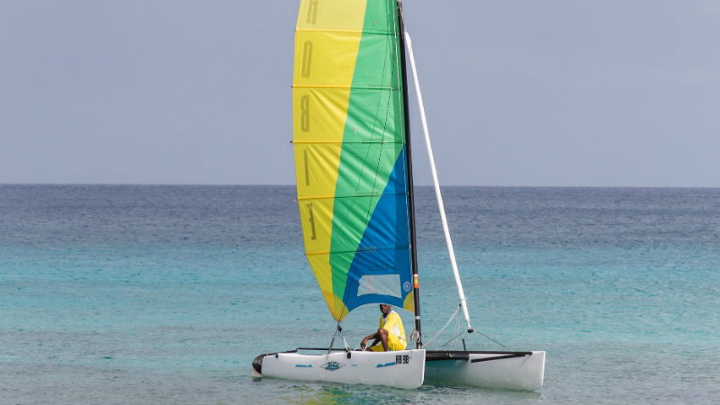 Sail boat on the ocean at the Crystal Cove by Elegant Hotels